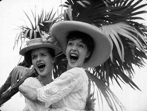 Leonore Faddish (Virginia Nicolson) and Mrs. Augustus Billings (Ruth Ford) are aghast at the goings-on near the end of the Cuba scenes.