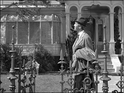 Figure 1: Elwood P. Dowd (James Stewart) relates to his invisible companion, Harvey.