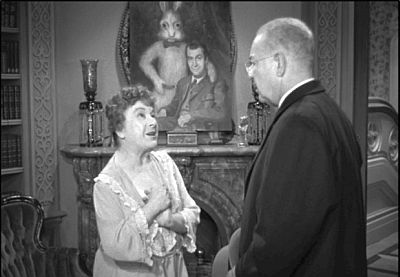 "Despite the indignities she has recently faced, Veta is still able to rhapsodize to Dr. Chumley (Cecil Kellaway) about ""the dream behind the reality"" as she stands with her back to a portrait of Elwood and Harvey."