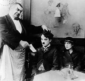 Chaplin with Campbell and Purviance in The Immigrant