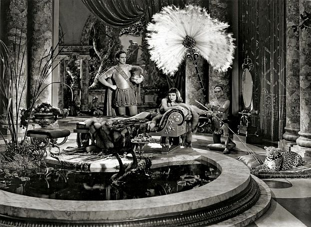Mitchell Leisen designed both this set and Claudette Colbert's costume.