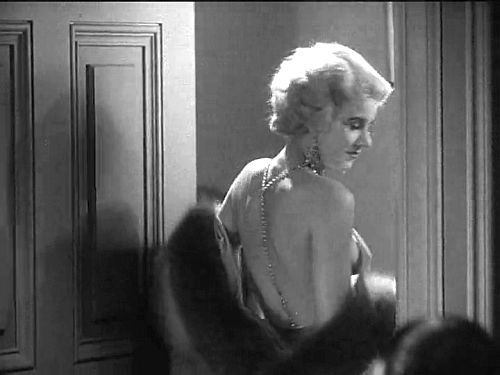 """Would you be shocked if I put on something more comfortable?"" Helen asks Monte. Photoplay editor James Quirk denounced Harlow's sexually predatory character (but not the actress) as ""sex in its most disgusting phase, naked, vulgar, unnecessary."""