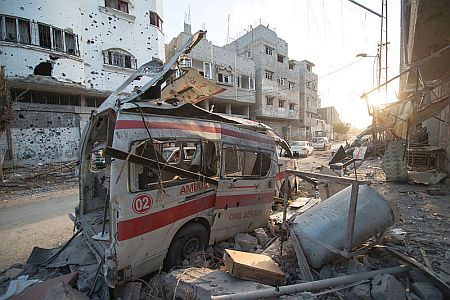 Ambulance in Gaza destroyed by Israeli airstrikes during Operation Protective Edge (2014). Photo by Boris Neihaus, courtesy of Wikimedia Commons