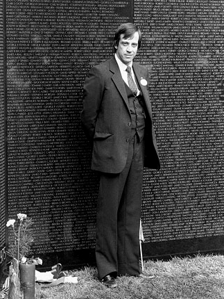 Jan C. Scruggs, founder of the Vietnam Veterans Memorial, standing at the apex of the Wall. ..Credit: Dane A. Penland (Smithsonian Institution). Used courtesy of Wikimedia Commons