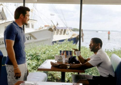He got game: Cain squares up to Denzel Washington in Out of Time.
