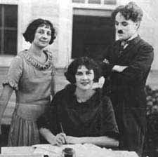 Lita Grey's mother, Lita, and Charlie at the signing of Lita's contract with Charlie's studio