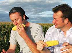 The boys eat corn