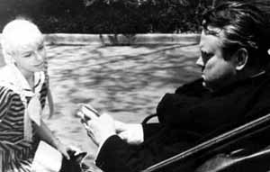 Patty McCormack and Orson Welles. Photo copyright Herederos Bunuel