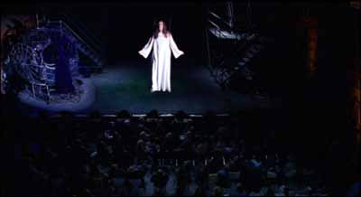 Above the audience, Jesus forgives his father