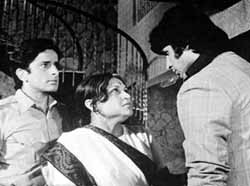 Shashi Kapoor, Nirupa Roy and Amitabh in Deewaar, 1975