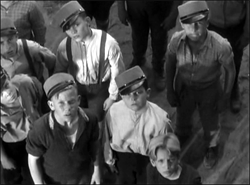 The Paul Street Boys assembled. In the foreground from left to right are Lieutenant Csonakos (Donald Haines), President Boka (Jimmie Butler) and Private Nemecsek, sans cap (George Breakston).