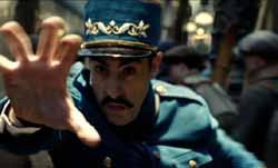 Sacha Baron Cohen as the inspector