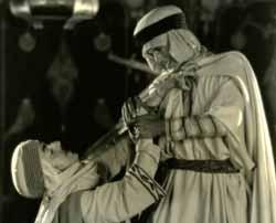 Gary Cooper strangles Noah Beery Sr. in Beau Sabreur