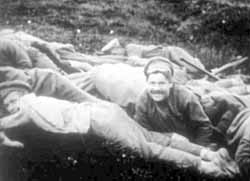 A Bolshevik laughs just before being shot to death
