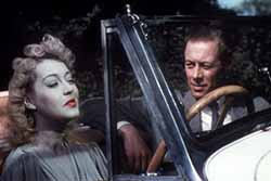Kay Hammond and Rex Harrison in Bilthe Spirit